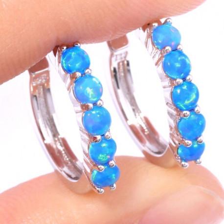Серьги в виде колец из серебра с голубыми опалами