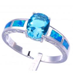 Кольцо из серебра с синим топазом 9 мм и голубыми опалами